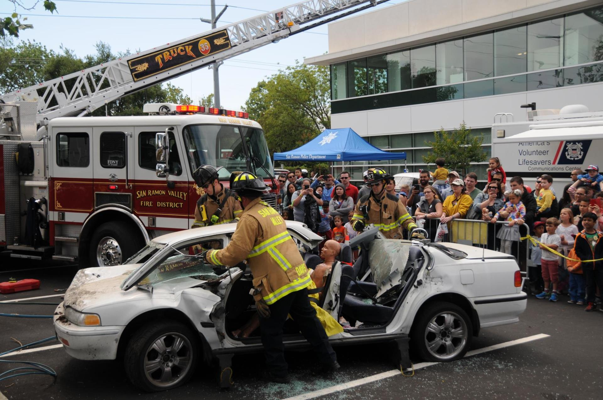Firefighters using Jaws of Life on Car